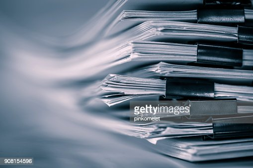 the extreamely close up  report paper stacking of office working document , retro color tone : Stock Photo