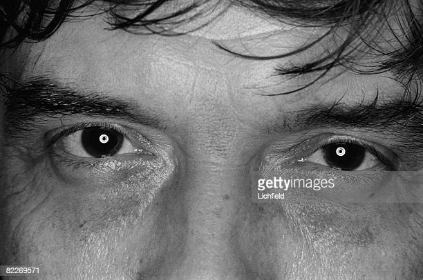 The eyes of British fashion photographer David Bailey photographed on 6th October 1983