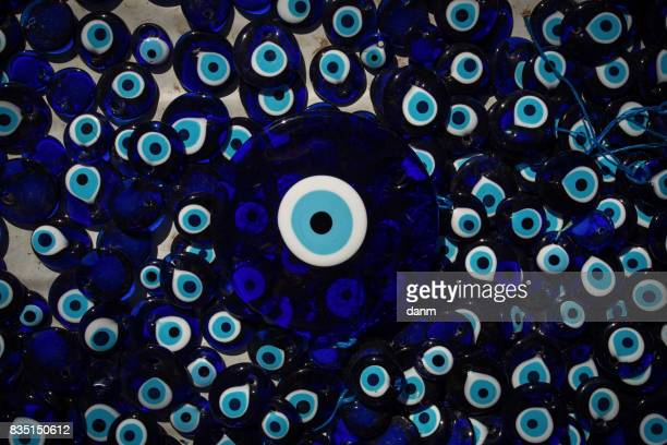 The eye-shaped amulets - Nazars, made of blue glass and believed to protect against the evil eye in Goreme national park, Cappadocia, Turkey.