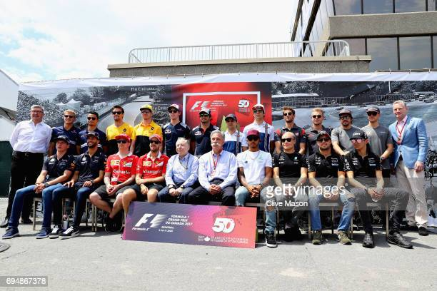 The F1 drivers and leadership stand together to celebrate 50 years of the Canadian Grand Prix during the Canadian Formula One Grand Prix at Circuit...