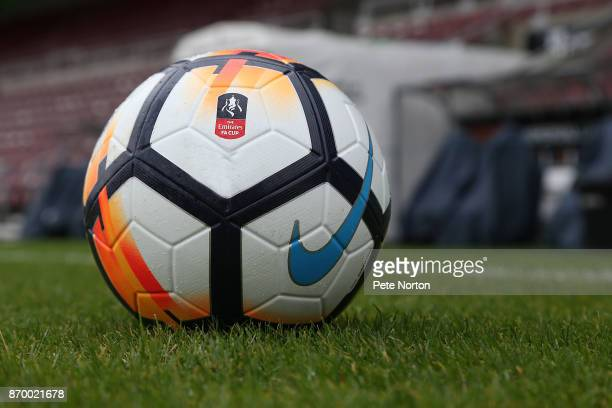 The FA Cup matchball is seen on the pitch prior to The Emirates FA Cup First Round match between Northampton Town and Scunthorpe United at Sixfields...