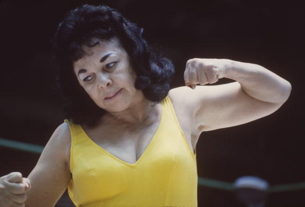 The Fabulous Moolah a professional wrestler punches her opponent ...