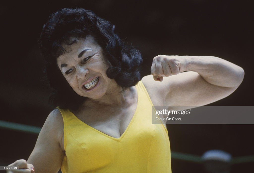 <a gi-track='captionPersonalityLinkClicked' href=/galleries/search?phrase=The+Fabulous+Moolah&family=editorial&specificpeople=2656770 ng-click='$event.stopPropagation()'>The Fabulous Moolah</a> a professional wrestler punches her opponent. Lillian Ellison, known in the ring as the Fabulous Moolah, is one of wrestling's pioneering veterans.
