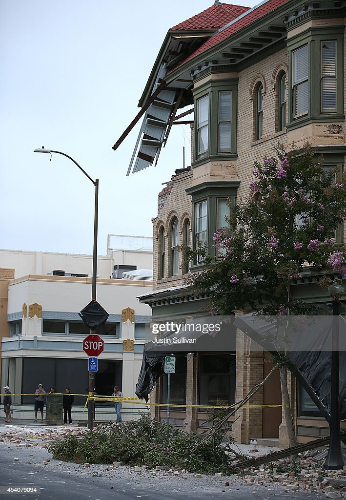 The facade of a building hangs over a sidewalk following a reported 6.0 earthquake on August 24, 2014 in Napa, California. A 6.0 earthquake rocked the San Francisco Bay Area shortly after 3:00 am on Sunday morning causing damage to buildings and sending at least 70 people to a hospital with non-life threatening injuries.