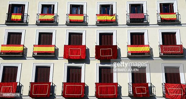 The facade of a building is decorated with the colors of Spain during the Holy Week in the historical centre of Madrid on April 4 2015 AFP PHOTO/...