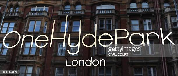 The facade of an old building is reflected in the sign for One Hyde Park in central London on March 22 2012 One Hyde Park is an exclusive residential...
