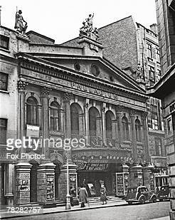 The facade of the London Palladium which is advertising the musical show 'Out Of This World' starring Frankie Howerd Binnie Hale and Nat Jackley 1948