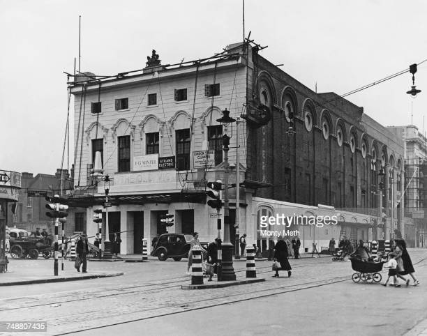 The facade of The Old Vic theatre on the corner of The Cut and Waterloo Road in Lambeth London getting its first coat of white paint during postwar...
