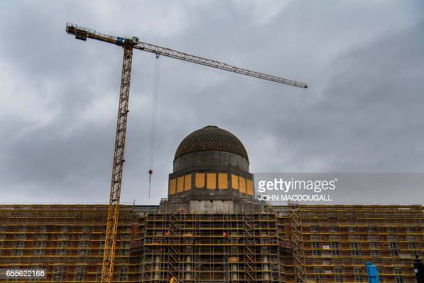 The facade of the soon to be completed Berlin Palace which will house the socalled Humboldt Forum museum is nearing completion on March 20 2017 / AFP...