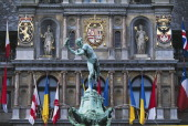 The facade of the Town Hall and the fountain dedicated to Silvius Brabo Antwerp Belgium