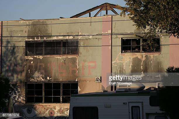 The face of a building that was the scene of a overnight fire that claimed the lives of at least nine people at a warehouse in the Fruitvale...