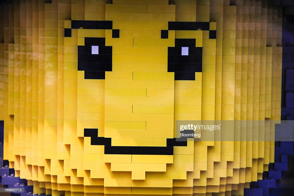 The face of a giant model soldier made of building blocks sits on display in the window of a Lego A/S toy store in Copenhagen, Denmark, on Friday, Jan. 11, 2013. The 'Lego Friends' series, introduced in January in most markets, is Lego's sixth attempt over the years to target girls and the 'most significant' new product in a decade, according to Chief Executive Officer Joergen Vig Knudstorp. Photographer: Freya Ingrid Morales/Bloomberg via Getty Images