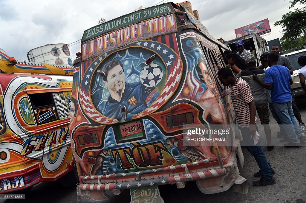The face of Argentinian football player Lionel Messi is seen painted on a Tap Tap public transportation vehicle, in Port-au-Prince on May 27, 2016. Haiti will play Brazil, Ecuador, and Peru in the upcoming COPA America Centerario soccer tournament in the United States taking place between June 3 and June 26, 2016. / AFP / HECTOR