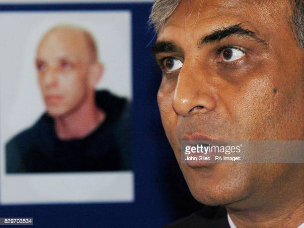 The face of Mark Hobson the man being sought by police in connection with four murders on a board behind Det Supt Javad Ali at a media conference in...