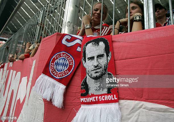The face of Mehmet Scholl is seen on a supporters scarf during the Franz Beckenbauer Cup match between Bayern Munich and Barcelona at the Allianz...
