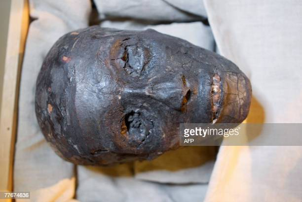 The face of Pharaoh Tutankhamen is displayed in a climatecontrolled case at his tomb in the Valley of the Kings close to Luxor 500 kilometres south...