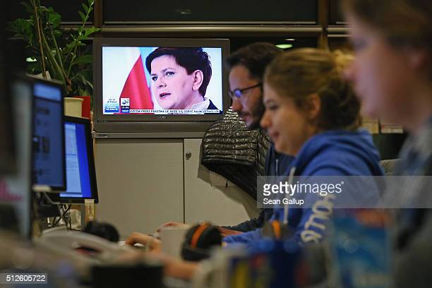 The face of Polish Prime Minister and member of the populist and conservative Law and Justice party Beata Szydlo appears on a television during a...