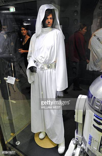 The face of Rebecca Melius from the Museum of Science in Boston is reflected in a mannequin wearing Princess Leia's dress used during the filming of...