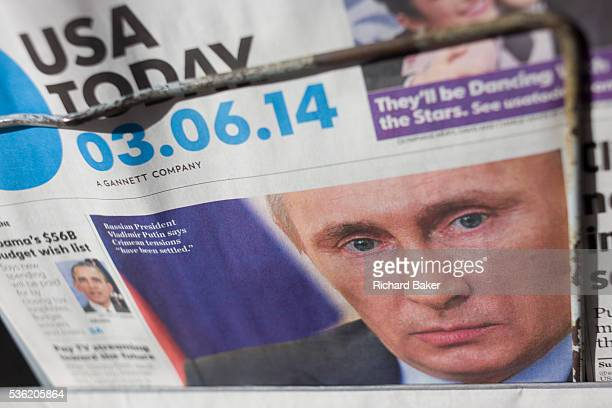 The face of Russian President Vladimirovich Putin appears on the front page of American global newspaper USA Today The detail shows us Putin's face...
