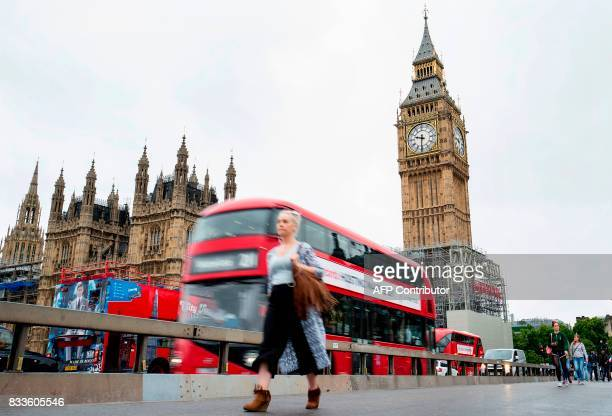 The face of the Great Clock of the Elizabeth Tower commonly referred to as Big Ben is pictured at the Houses of Parliament in London on August 17 as...