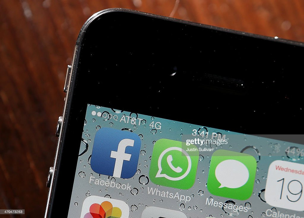 The Facebook and WhatsApp app icons are displayed on an iPhone on February 19 2014 in San Francisco City Facebook Inc announced that it will purchase...