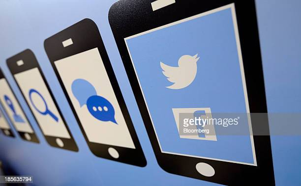 The Facebook Inc and Twitter Inc company logos are seen on an advertising sign during the Apps World MultiPlatform Developer Show in London UK on...