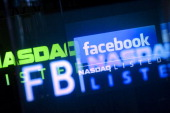 The Facebook Inc logo is displayed at the Nasdaq MarketSite in New York US on Friday May 18 2012 Facebook Inc rose in its trading debut following a...