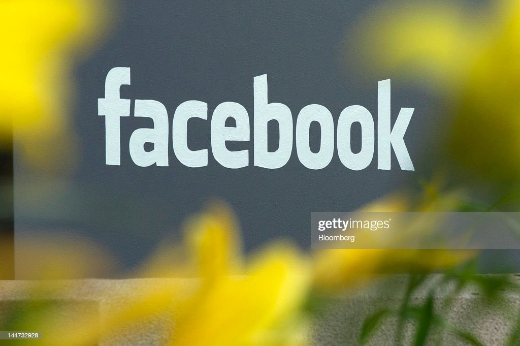 The Facebook Inc. logo is displayed in front of the company's headquarters in Menlo Park, California, U.S., on Friday, May 18, 2012. Facebook Inc. is set to start trading today after a record initial public offering that made the social network more costly than almost every company in the Standard & Poor's 500 Index. Photographer: David Paul Morris/Bloomberg via Getty Images