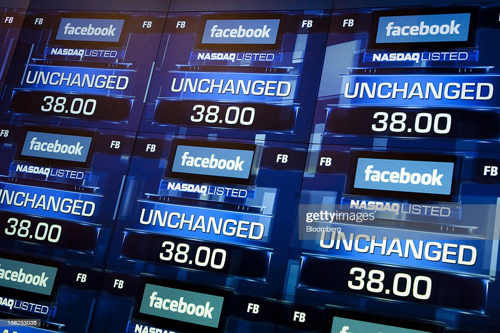'BEST PHOTOS OF 2012' (): The Facebook Inc. logo is displayed with the word 'unchanged' prior to trading at the Nasdaq MarketSite in New York, U.S., on Friday, May 18, 2012. Nasdaq OMX Group Inc. experienced a delay in opening shares of Facebook Inc., with trading beginning at about 11:30 a.m. instead of the planned 11:00 a.m. start. Facebook Inc. rose in its trading debut following a record initial public offering that made the social network more costly than almost every company in the Standard & Poor's 500 Index. Photographer: Scott Eells/Bloomberg via Getty Images