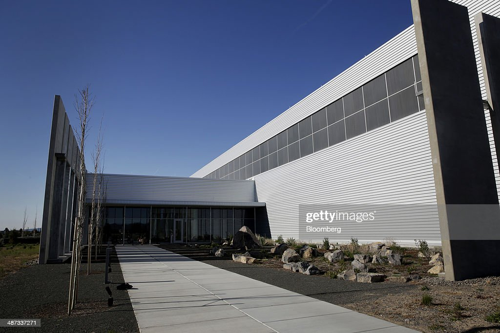 The Facebook Inc. Prineville Data Center stands in Prineville, Oregon, U.S., on Monday, April 28, 2014. The Facebook Prineville Data Center features leading energy-efficient technology, including features such as rainwater reclamation, a solar energy installation for providing electricity to the office areas and reuse of heat created by the servers to heat office space. Photographer: Meg Roussos/Bloomberg via Getty Images