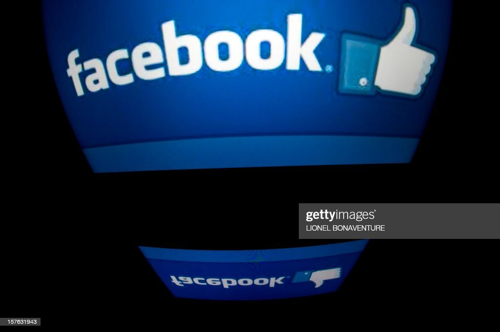 The 'Facebook' logo is seen on a tablet screen on December 4 2012 in Paris AFP PHOTO / LIONEL BONAVENTURE