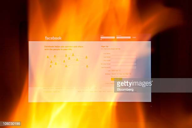 The Facebook website is seen through fire on a computer screen in this photo arranged in Beijing China on Thursday Feb 17 2011 Facebook Inc users in...