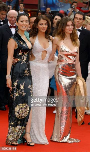 The faces of L'Oreal models Gong Li Aishwarya Rai and Laetita Casta arrive for the screening of Bad Education a film by Pedro Almodovar at the Palais...