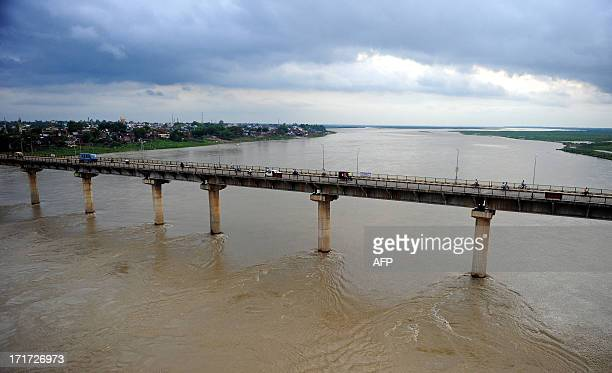 The Fafamau bridge is pictured as the water level of the Ganges and Yamuna rivers rise in Allahabad India's Uttar Pradesh state on June 28 2013 Early...