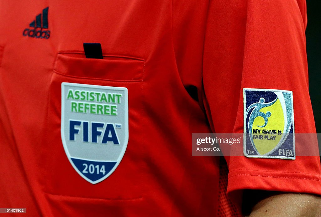 The Fair Play batch of the Assistant Referee is seen on the shirt during the 2014 FIFA World Cup Brazil Round of 16 match between Colombia and...