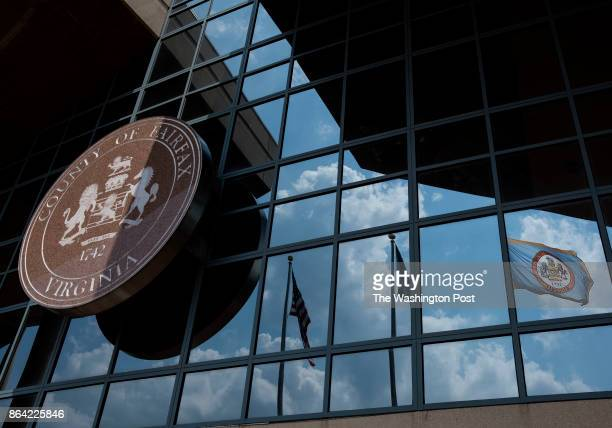 The Fairfax County flag waves in the wind outside the Fairfax County Government Center in Fairfax Virginia on June 14 2017 Inside people work to...