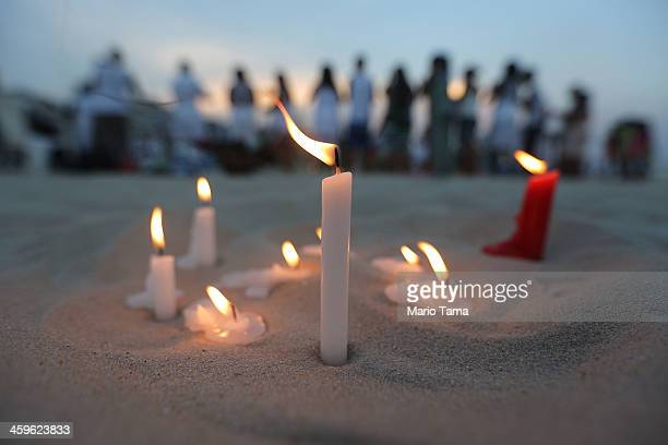 The faithful gather for a ceremony honoring Iemanja Goddess of the Sea as part of traditional New Year's celebrations on the sands of Copacabana...