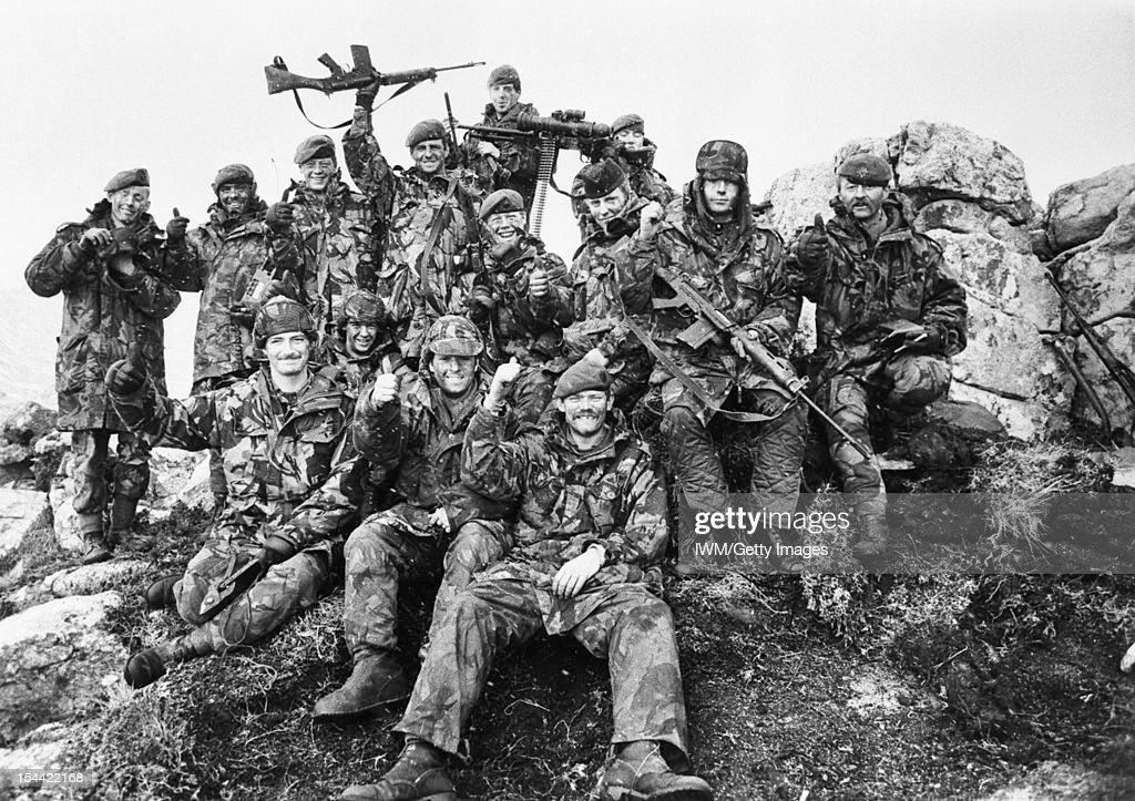 The Falklands Conflict, April - June 1982, 7 Platoon, G Company, 2nd Battalion Scots Guards on Mount Tumbledown celebrate the news of the Argentine surrender at dawn on 14 June 1982.