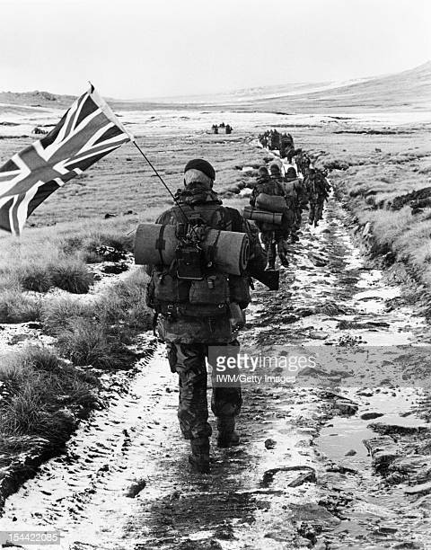 The Falklands Conflict April June 1982 Commandos from 40 Commando AntiTank Troop march towards Port Stanley in amongst a column of from 45 Commando...