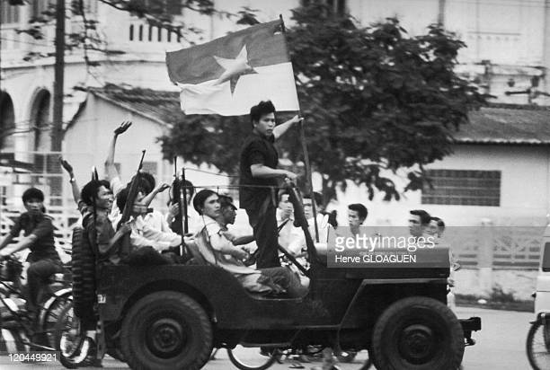 The Fall of Saigon in Vietnam on April 30 1975 NLF guerrila fighters on the day of liberation Here the first Jeep announcing the arrival of North...
