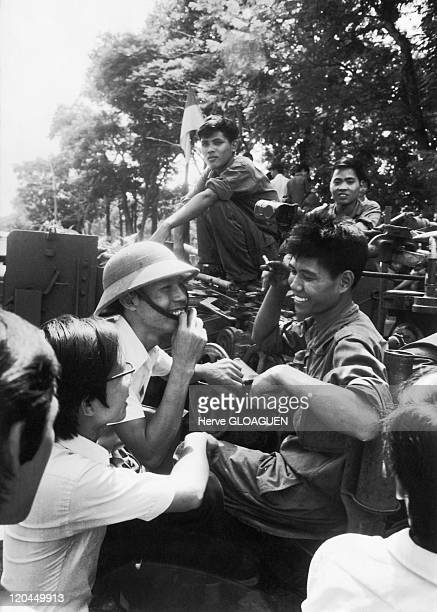 The Fall of Saigon in Vietnam on April 30 1975 Saigon's inhabitants reassured by the absence of combat fraternize with the northVietnameses troops