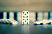 A domino in the middle with a blurred background.