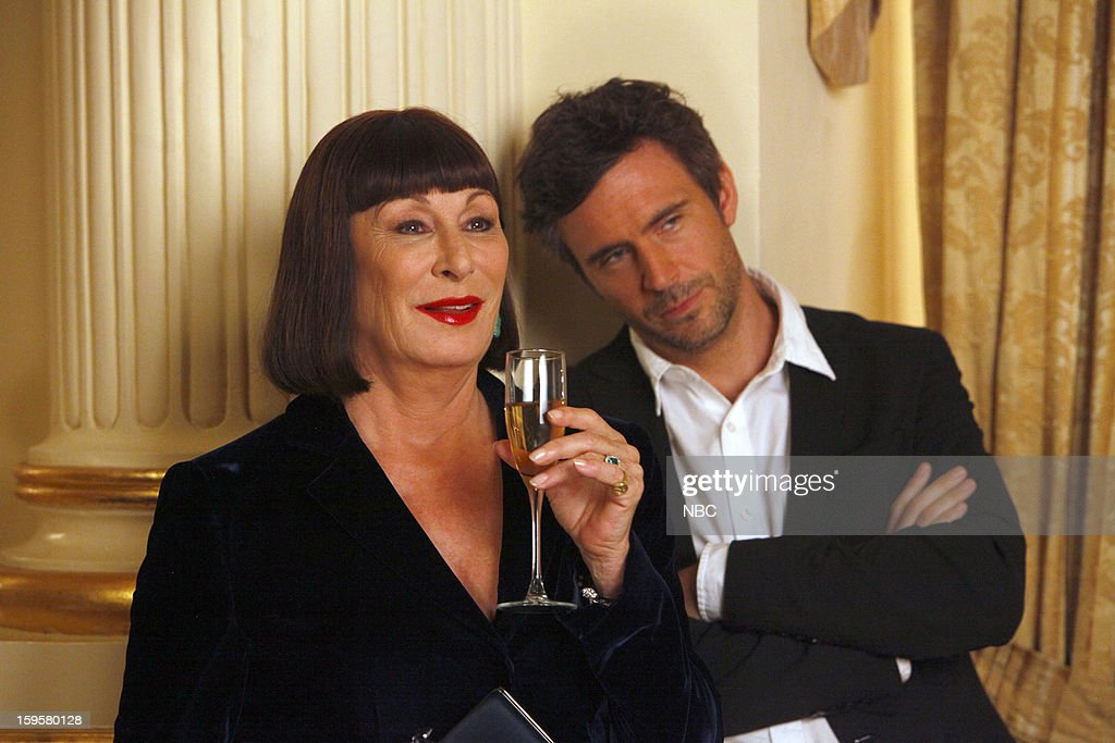 SMASH -- 'The Fallout' Episode 202 -- Pictured: (l-r) Anjelica Huston as Eileen Rand, Jack Davenport as Derek Wills --