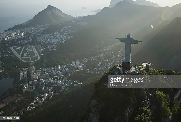 The famed Christ the Redeemer statue is seen atop Corcovado mountain in an aerial view on February 24 2015 in Rio de Janeiro Brazil The Art Deco...