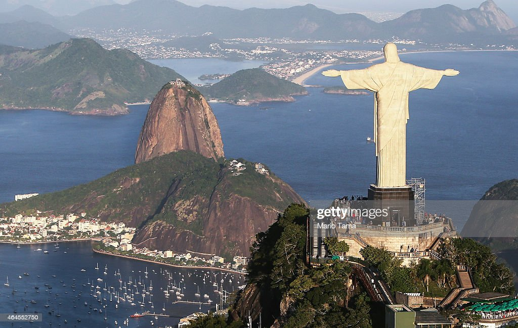 The famed Christ the Redeemer statue stands above Guanabara Bay in an aerial view on February 24, 2015 in Rio de Janeiro, Brazil. The Art Deco statue is 38 meters tall and was inaugurated in 1931. Rio marks its 450th anniversary on March 1st and is celebrating the event with a yearlong series of events including concerts, exhibitions, historical tours, soccer matches, fireworks displays and other activities. The 'Marvelous City' was founded in 1565 by the Portuguese and was the seat of power of the Portuguese Empire in the 19th century before serving as the capital of the Brazilian Republic until 1960. The city is BrazilÕs most popular tourist destination and will host the Rio 2016 Olympic Games, the first to be held in South America, next year.
