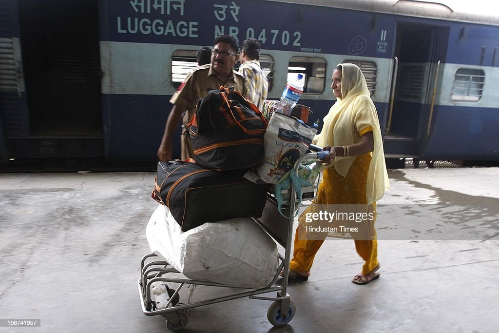 'ATTARI, INDIA - AUGUST 16: The families of Pakistani Hindus at Attari Railway Station after reaching in India through Samjautha Express on August 16, 2012 in Attari, India. (Photo by Munish Byala/Hindustan Times via Getty Images)'