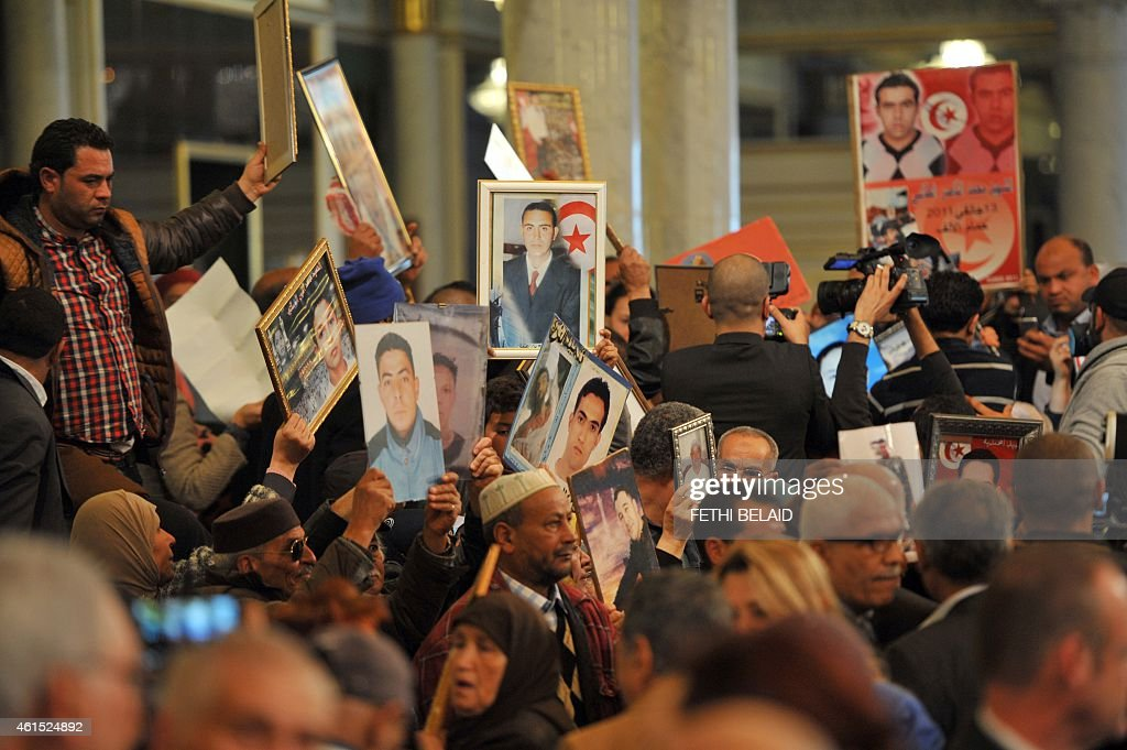 The families of the victims and wounded of the Tunisian revolution shout slogans and interrupt celebrations during an event at the presidential palace in Tunis on January 14, 2015, marking the fourth anniversary of the ousting of Tunisia's longtime ruler Zine el Abidine Ben Ali, that sparked the Arab Spring uprisings. On January 14, 2011, under massive popular pressure over unemployment and inflation, Ben Ali fled to Saudi Arabia with his family after 23 years in power.