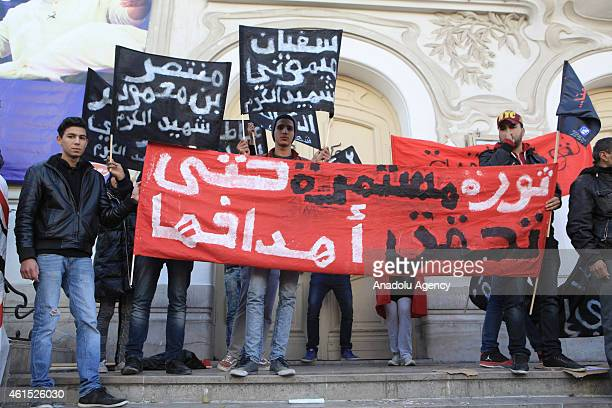 The families of the victims and wounded of the Tunisian revolution hold banners at the Habib Bourguiba street at the 4th anniversary of the January...