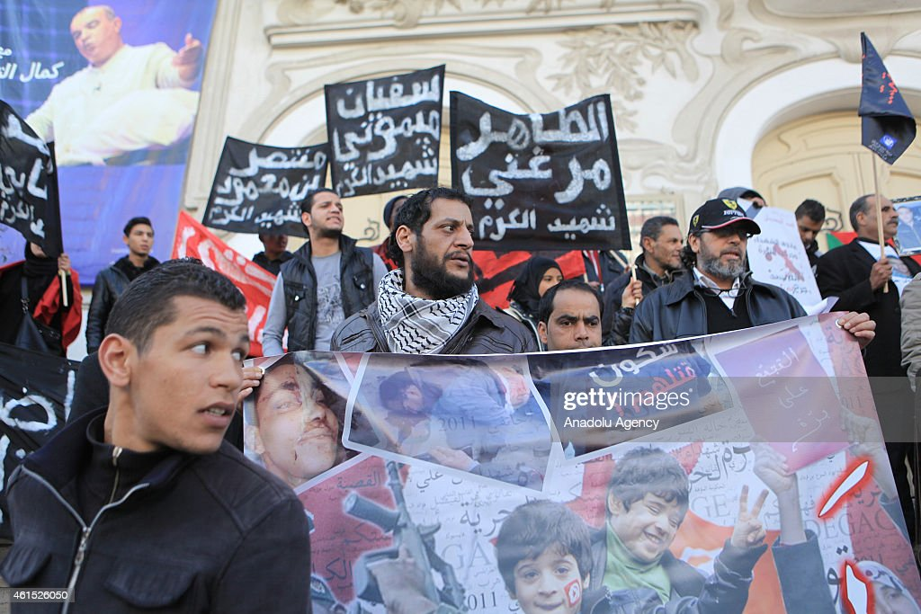 The families of the victims and wounded of the Tunisian revolution hold banners at the <a gi-track='captionPersonalityLinkClicked' href=/galleries/search?phrase=Habib+Bourguiba&family=editorial&specificpeople=213571 ng-click='$event.stopPropagation()'>Habib Bourguiba</a> street at the 4th anniversary of the January 14 revolution, in Tunis on January 14,2015.