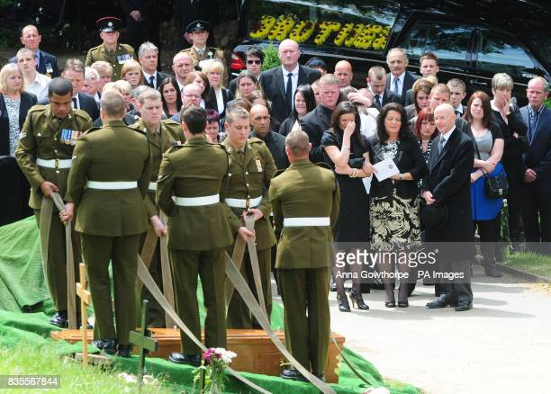 The family and friends of the killed British soldier Sapper Jordan Rossi look on during the interment at his funeral held at Saltaire United Reform...